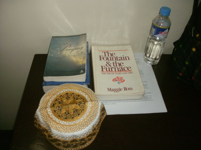 Three of  my retreat companions - Nan C. Merrill's Psalms for Praying, Mggie Ross's The Fountain and the Furnace, and a taqqiyah i would wear during prayer times in solidarity with the Muslims who pray 5 times  a day to the One God.